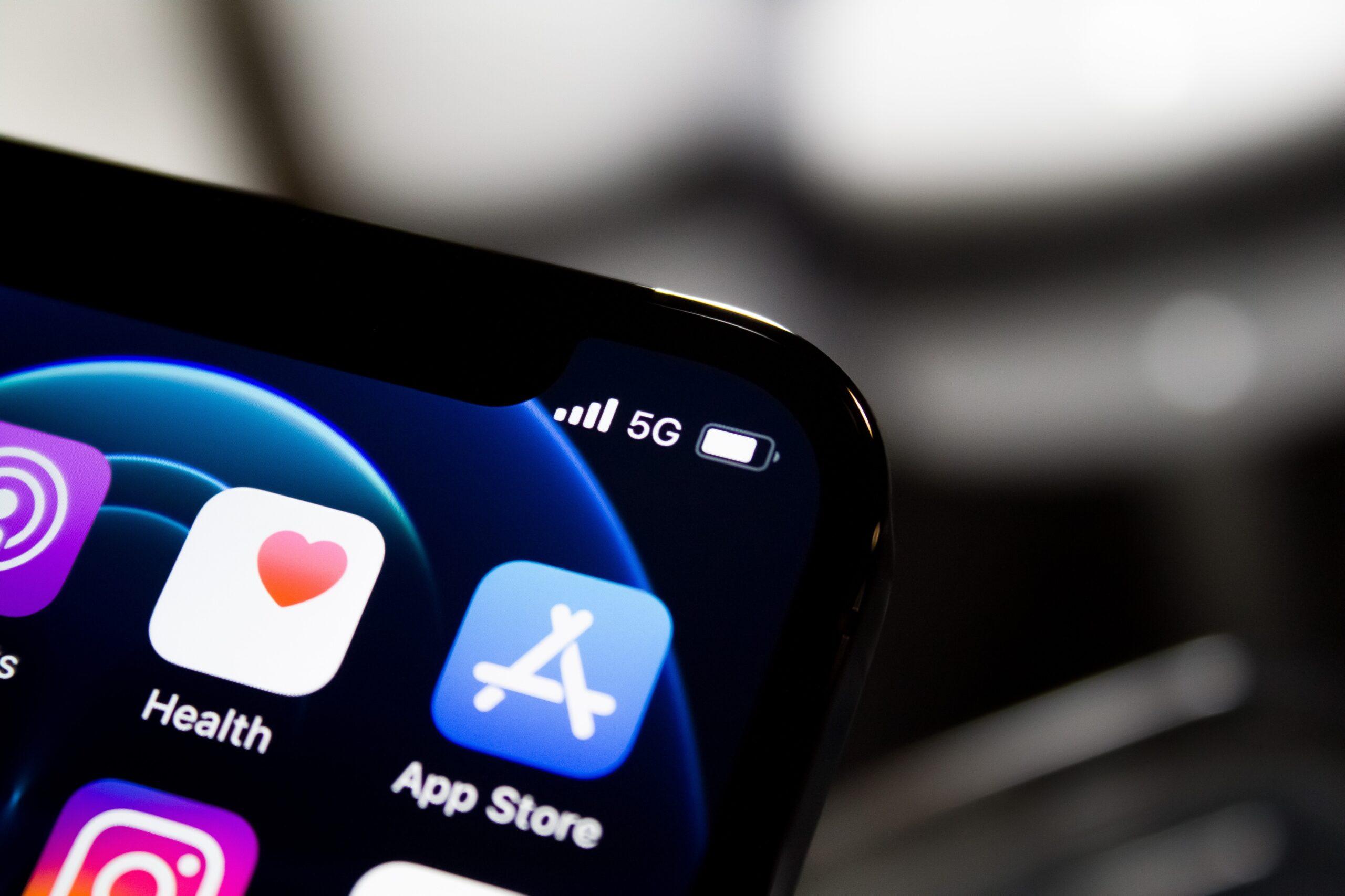 black iphone 4 displaying icons