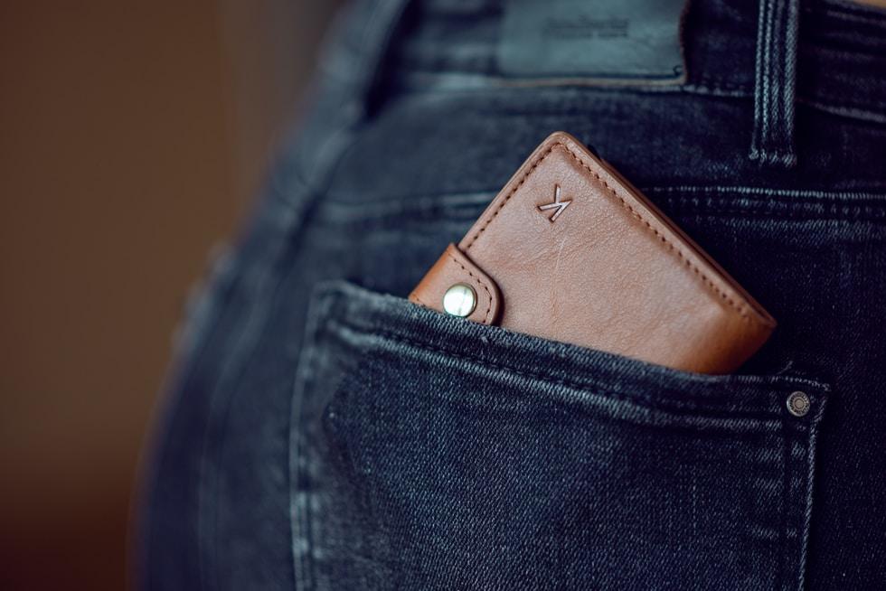 black leather wallet on blue denim jeans