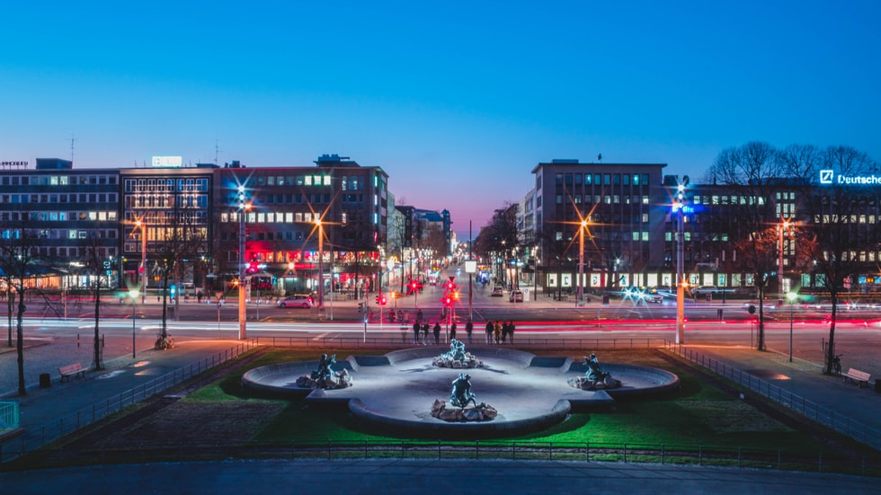 water fountain in the middle of the city during night time