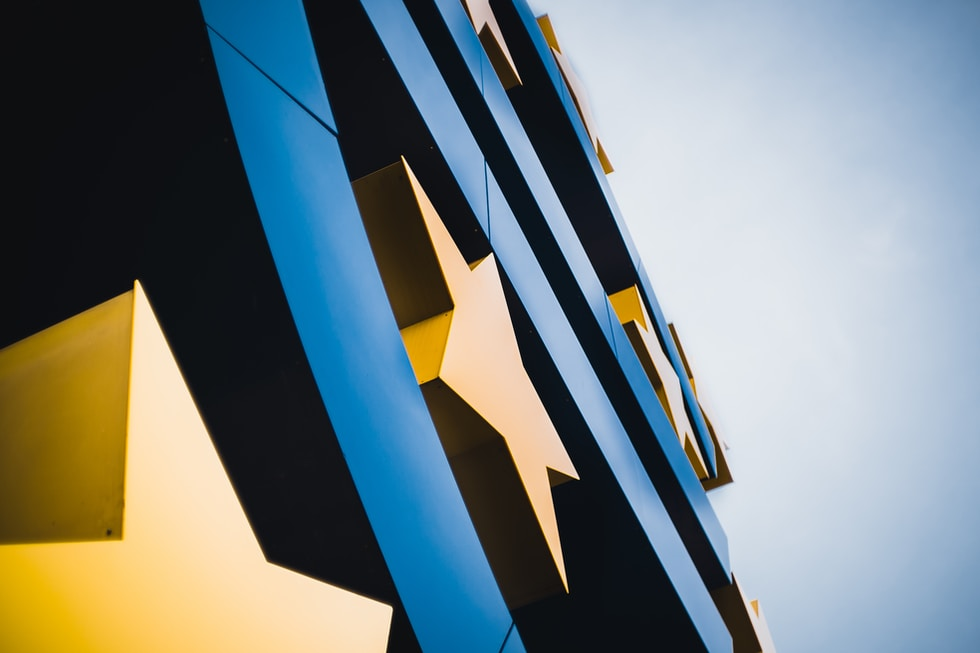 blue and yellow building under blue sky during daytime